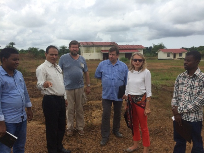 BRAC team with EU delegates in a hatchery and feed mill in Liberia.