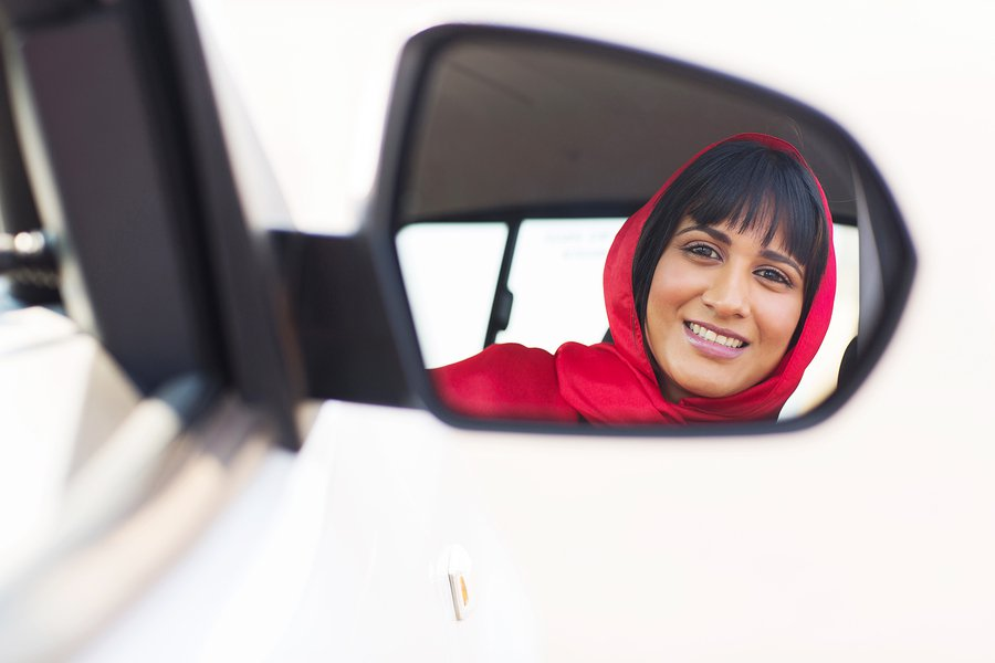 bigstock-happy-female-driver-loo-73320853